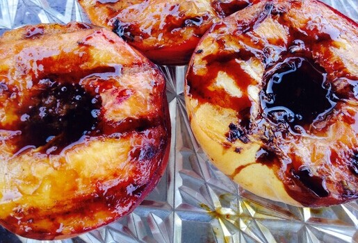 Grilled Peaches Coated with Bourbon Sauce